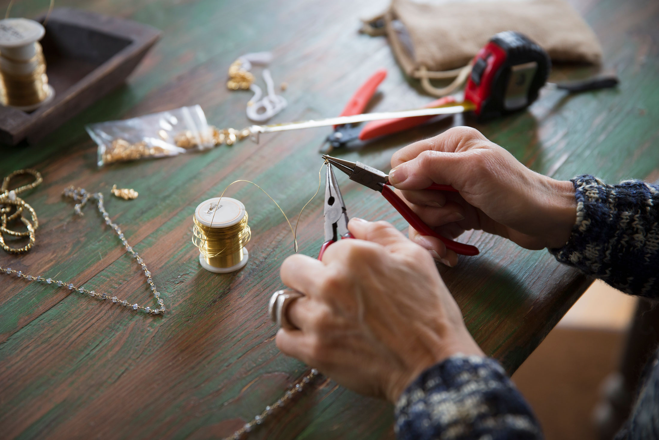 Skillful hands masterfully cutting delicate jewelry wire.