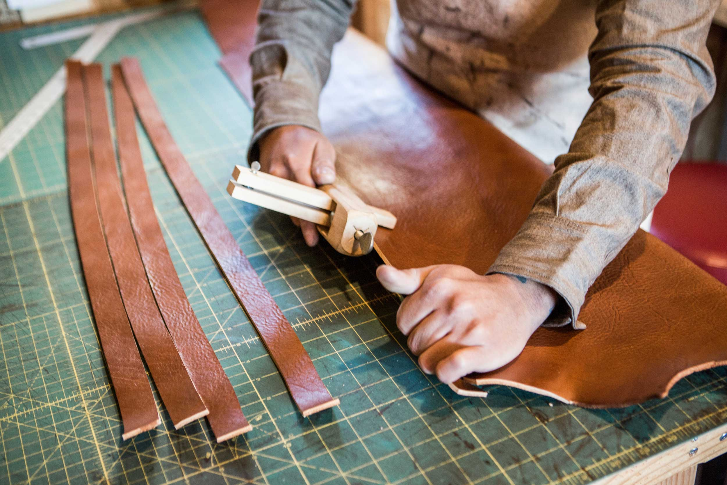 Strong hands working with tough, beautiful leather.