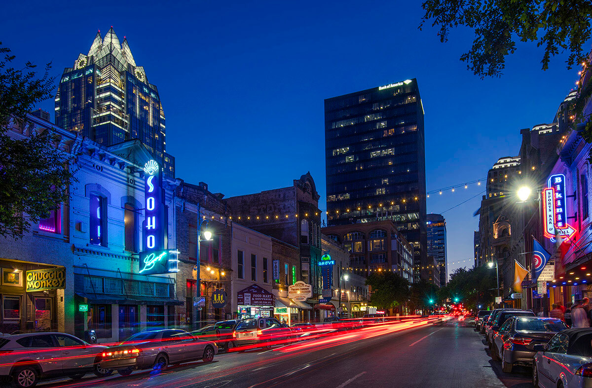 A lively cityscape of the city of Austin, Texas at night.