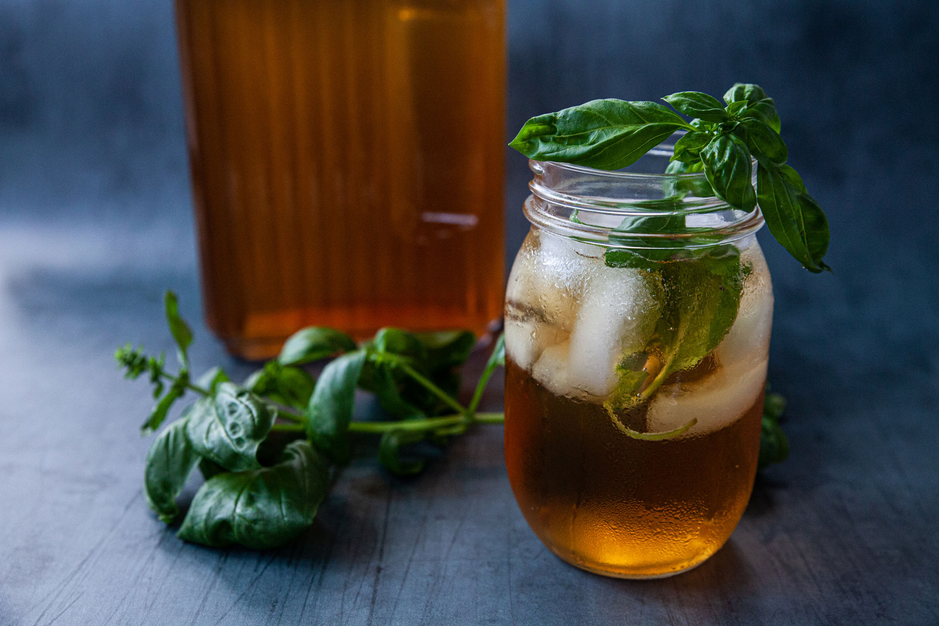 A glass mason jar filled with cold, refreshing iced tea.