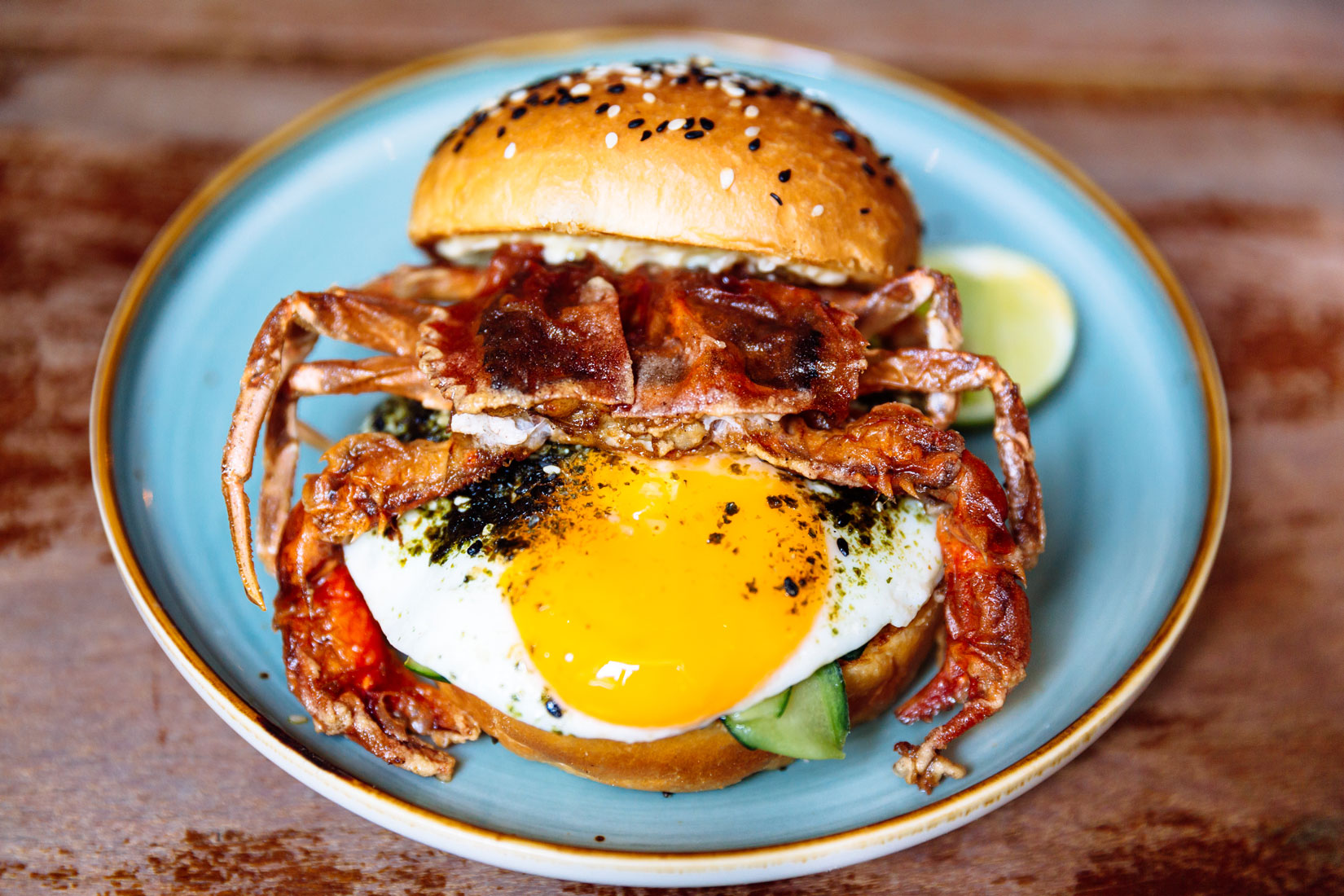 A delicious crab burger with a freshly fried egg.