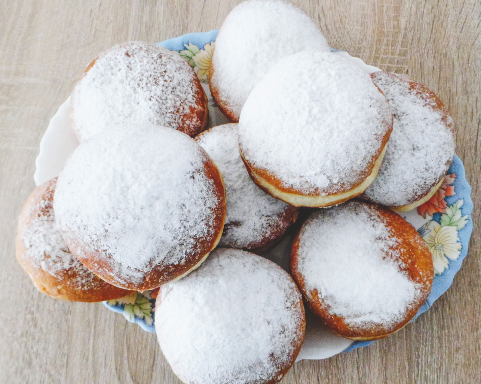 A large plate overwhelmed with delicious Paczki.