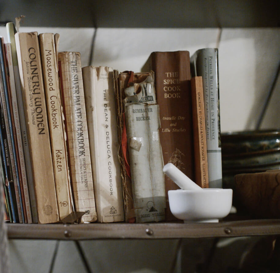 A shelf filled with Erica's avidly used cookbooks