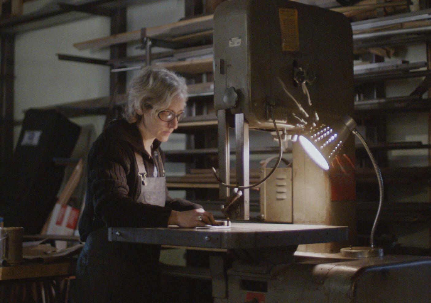 Erica focusing on her work in her shop.