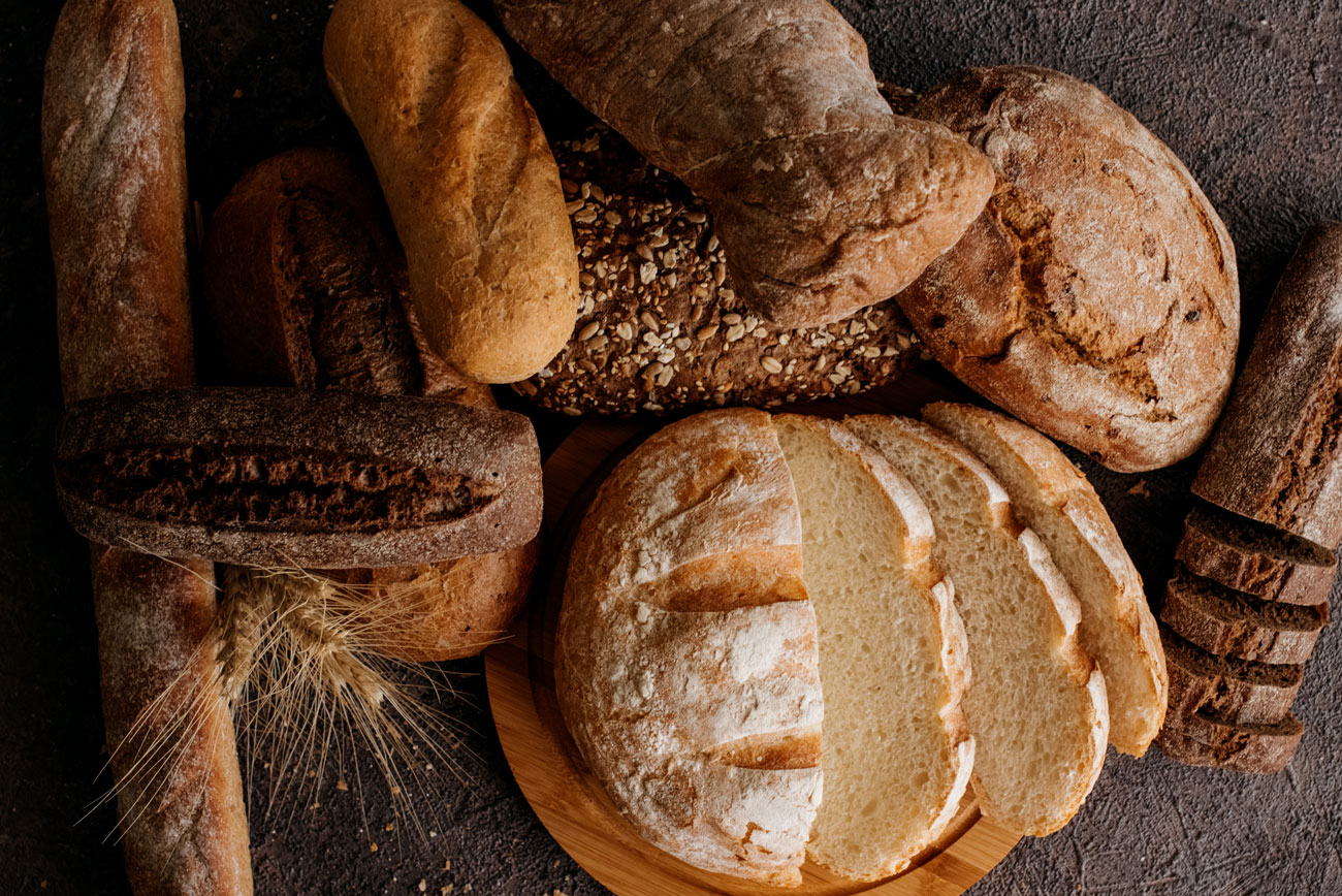 A variety of fresh loaves of bread.