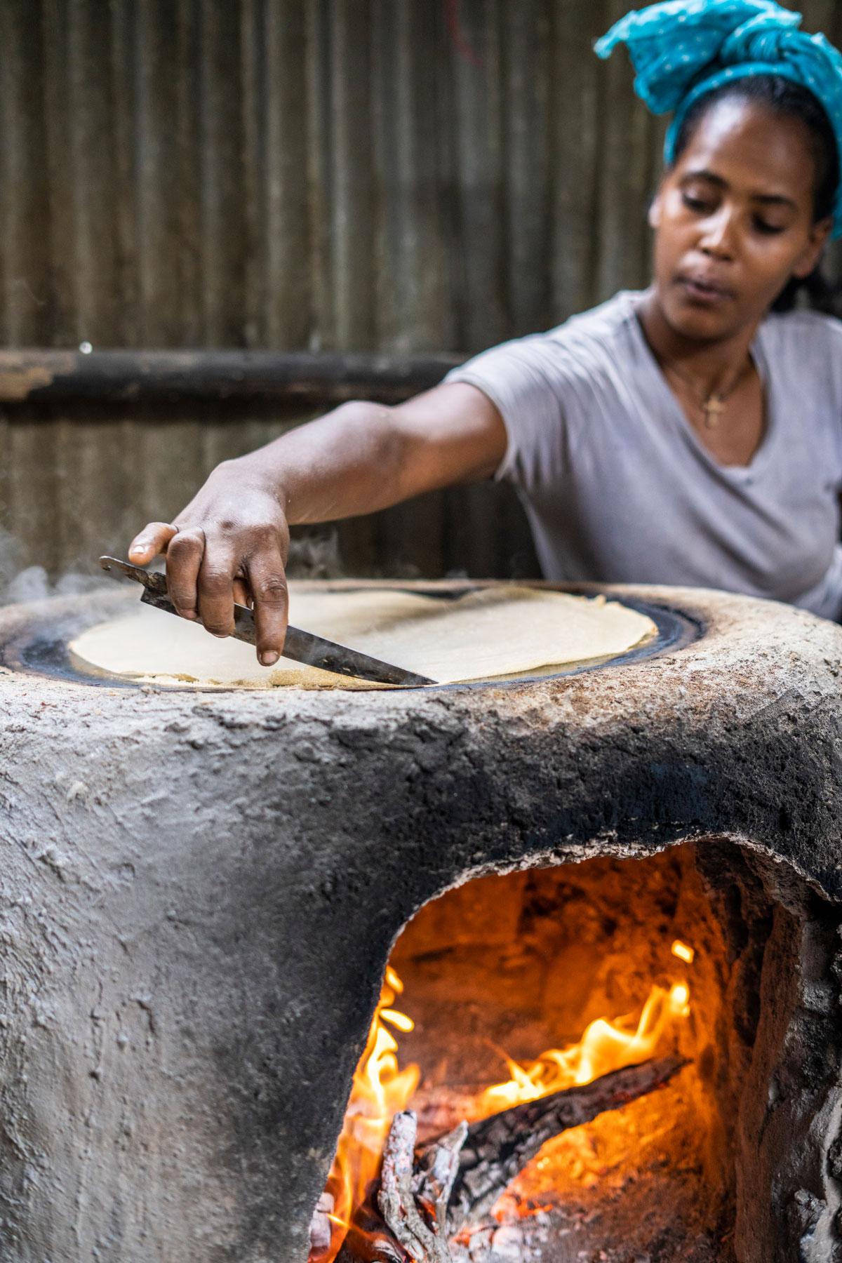 A person making Ethiopian flatbread.