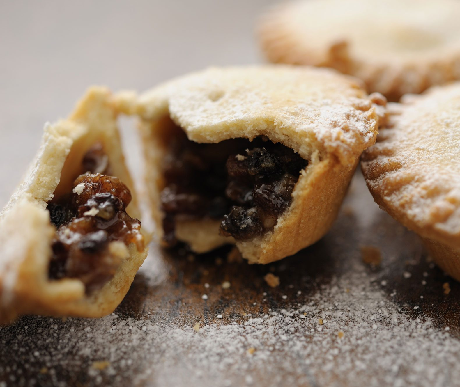 A mince pie broken apart to show its inside.