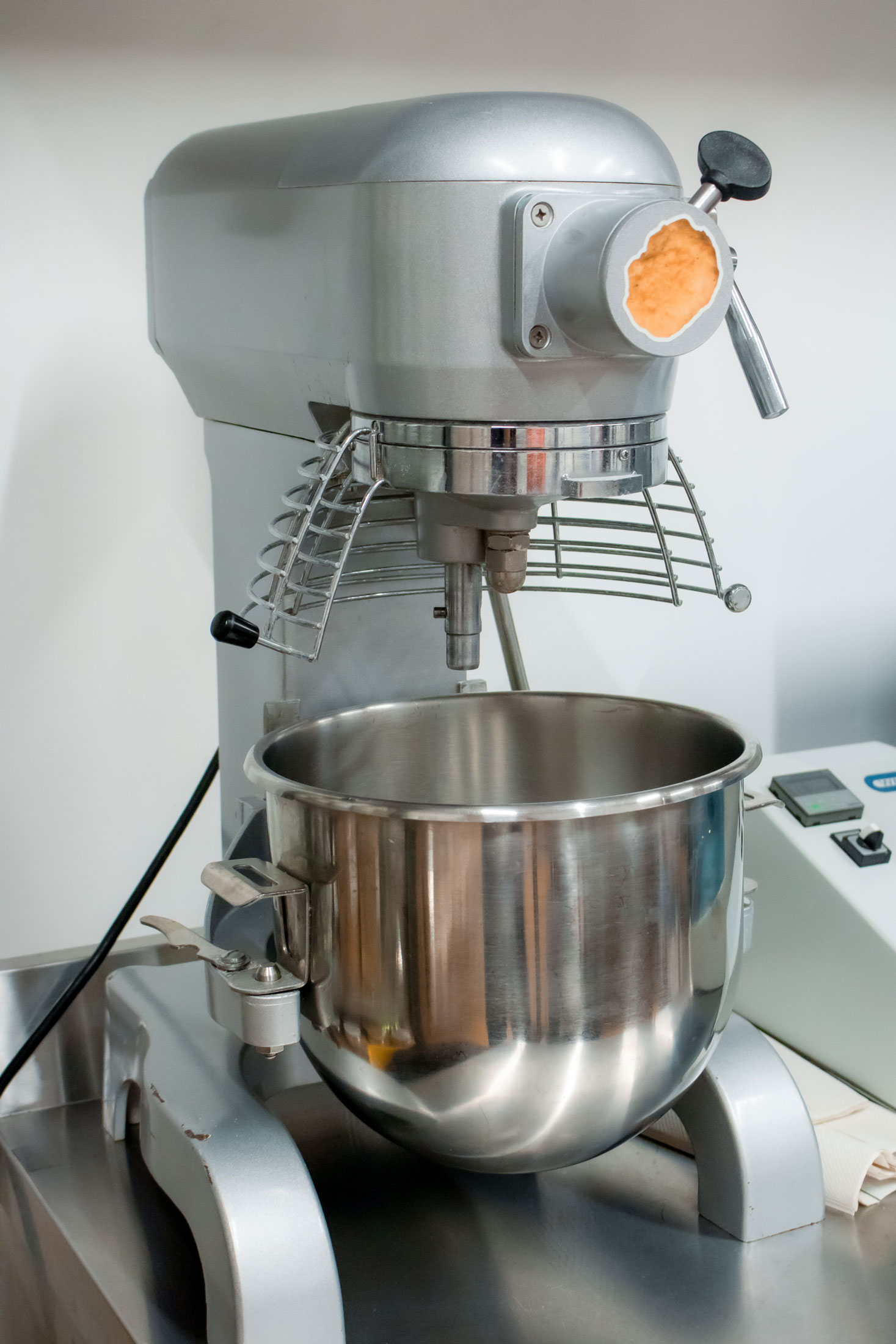 A large, powerful mixer used to blend the ingredients of the plant-based nuggets.