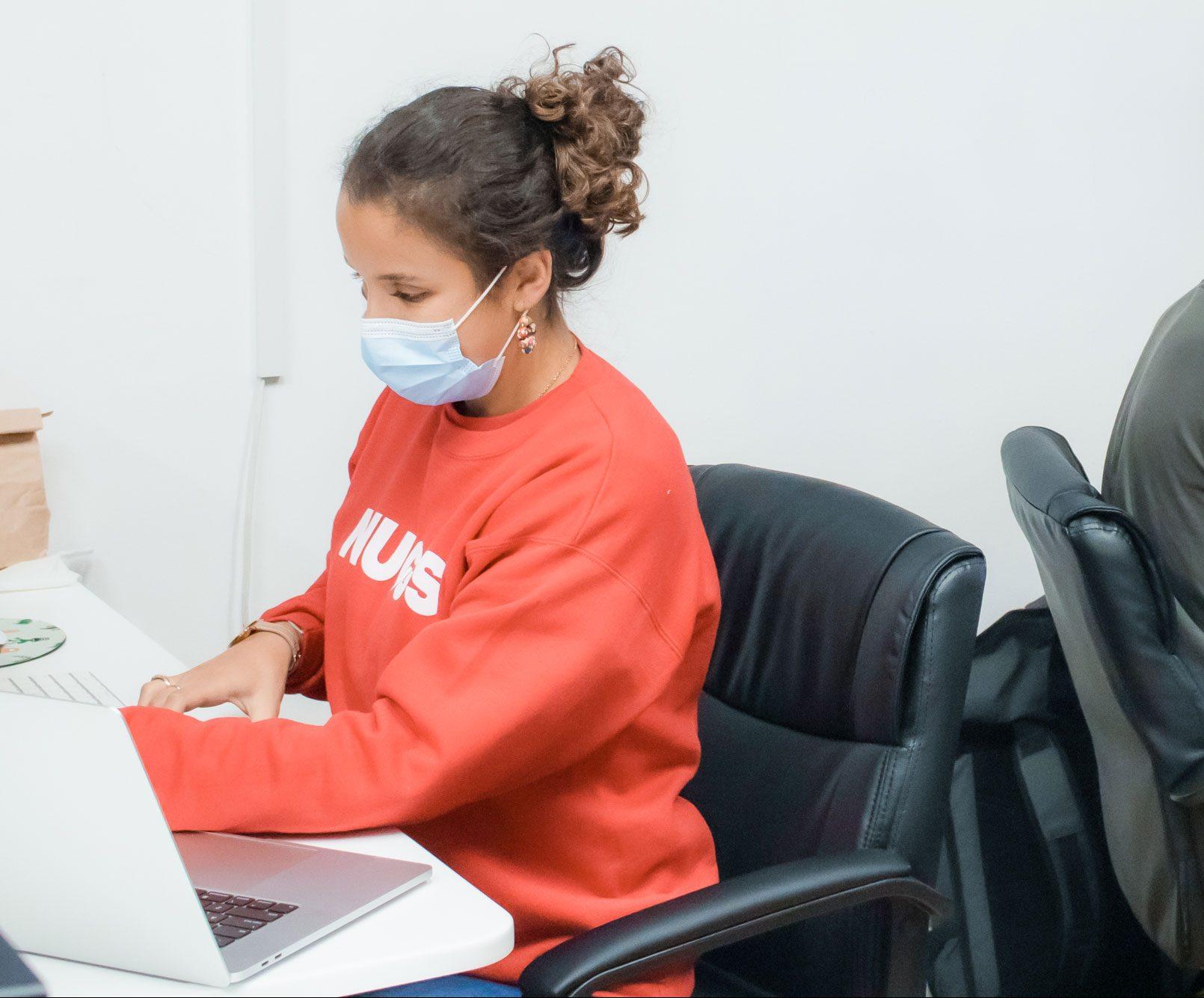 Gabriela, a Nuggs food engineer, working at her desk.