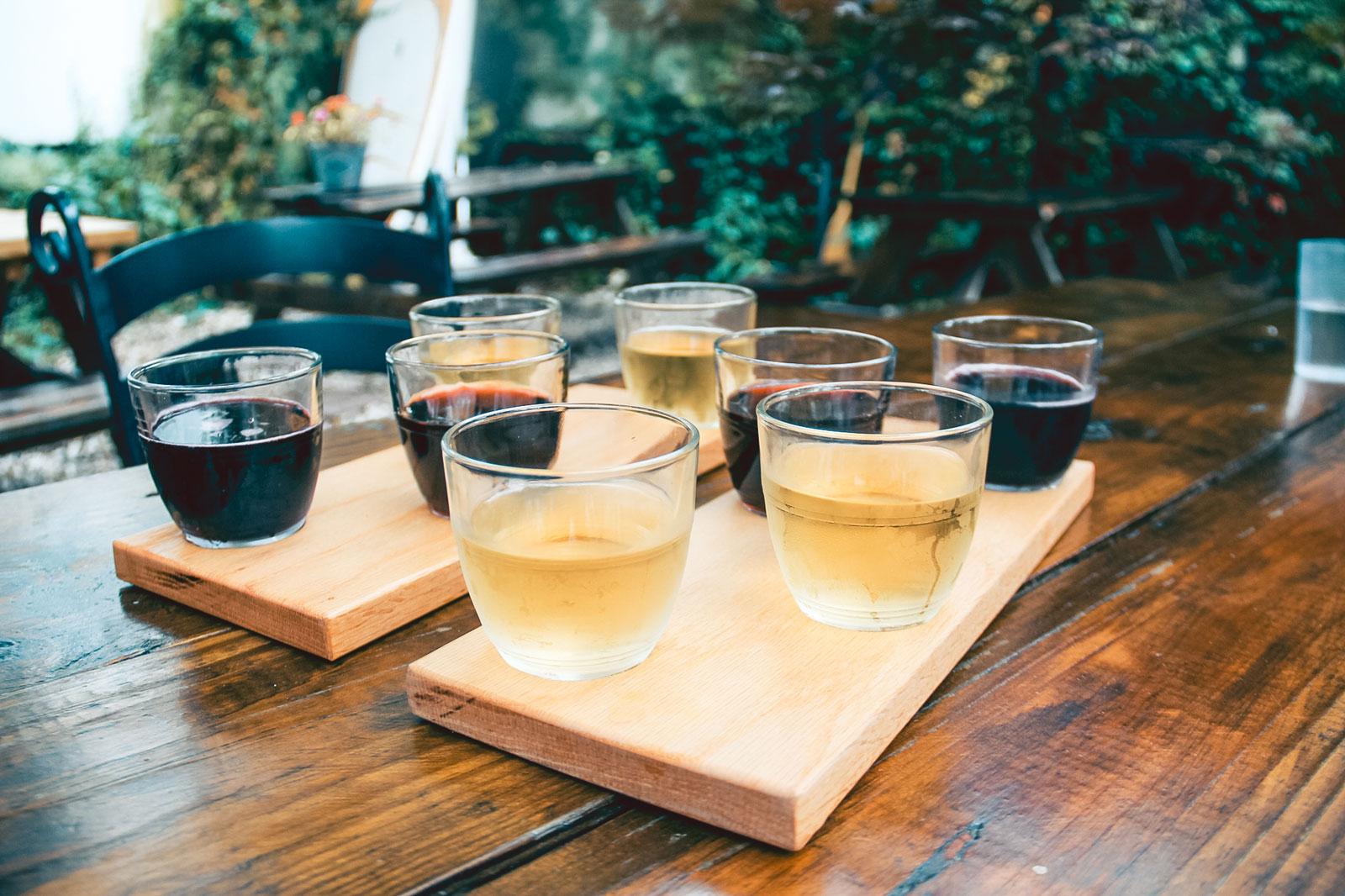 Multiple glasses of wine in a sampler.