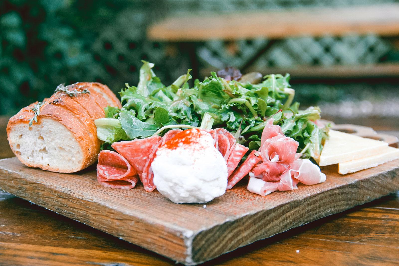 Close-up of salami and cheese board.