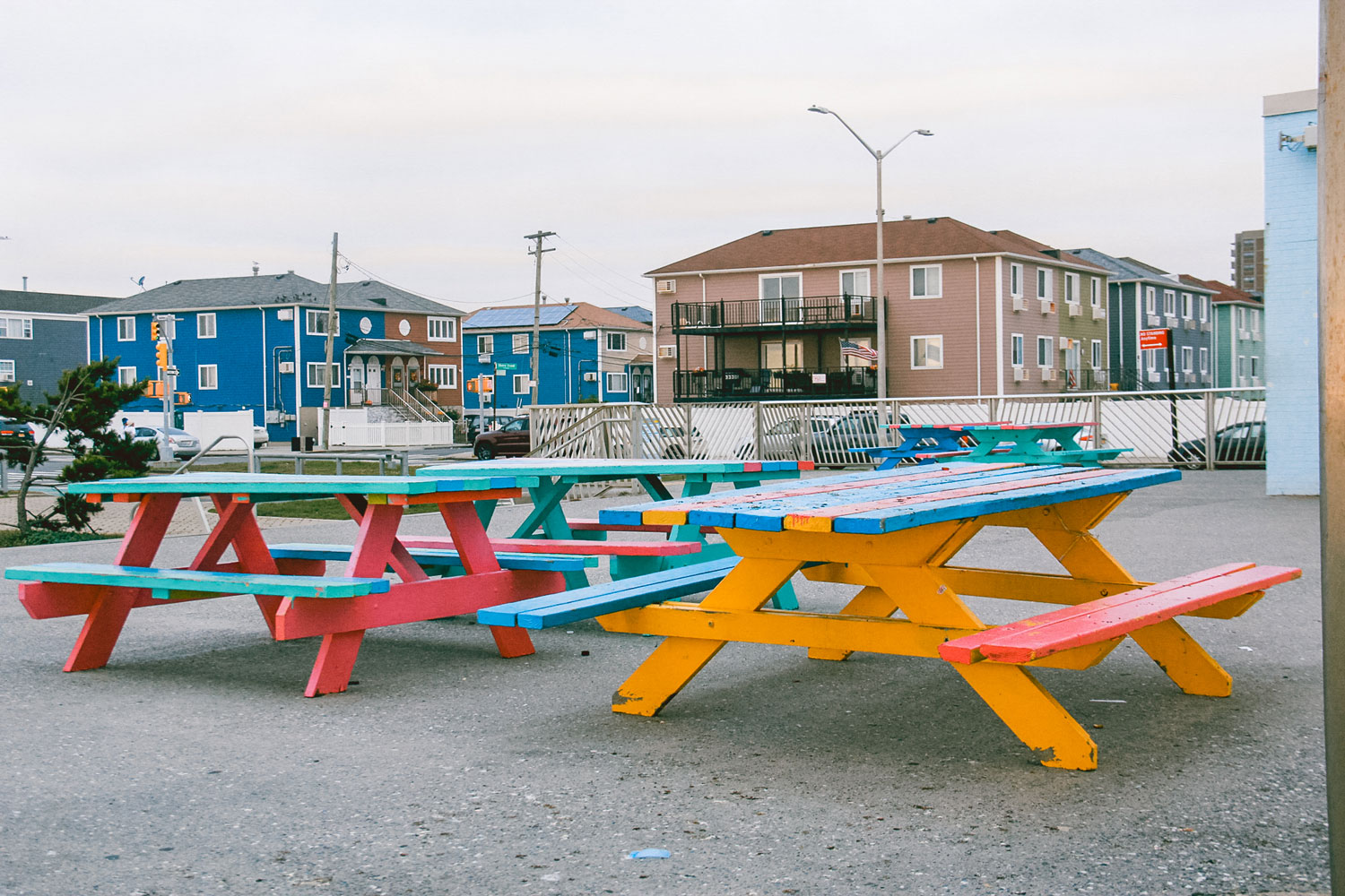 Colorful picnic tables in a park.