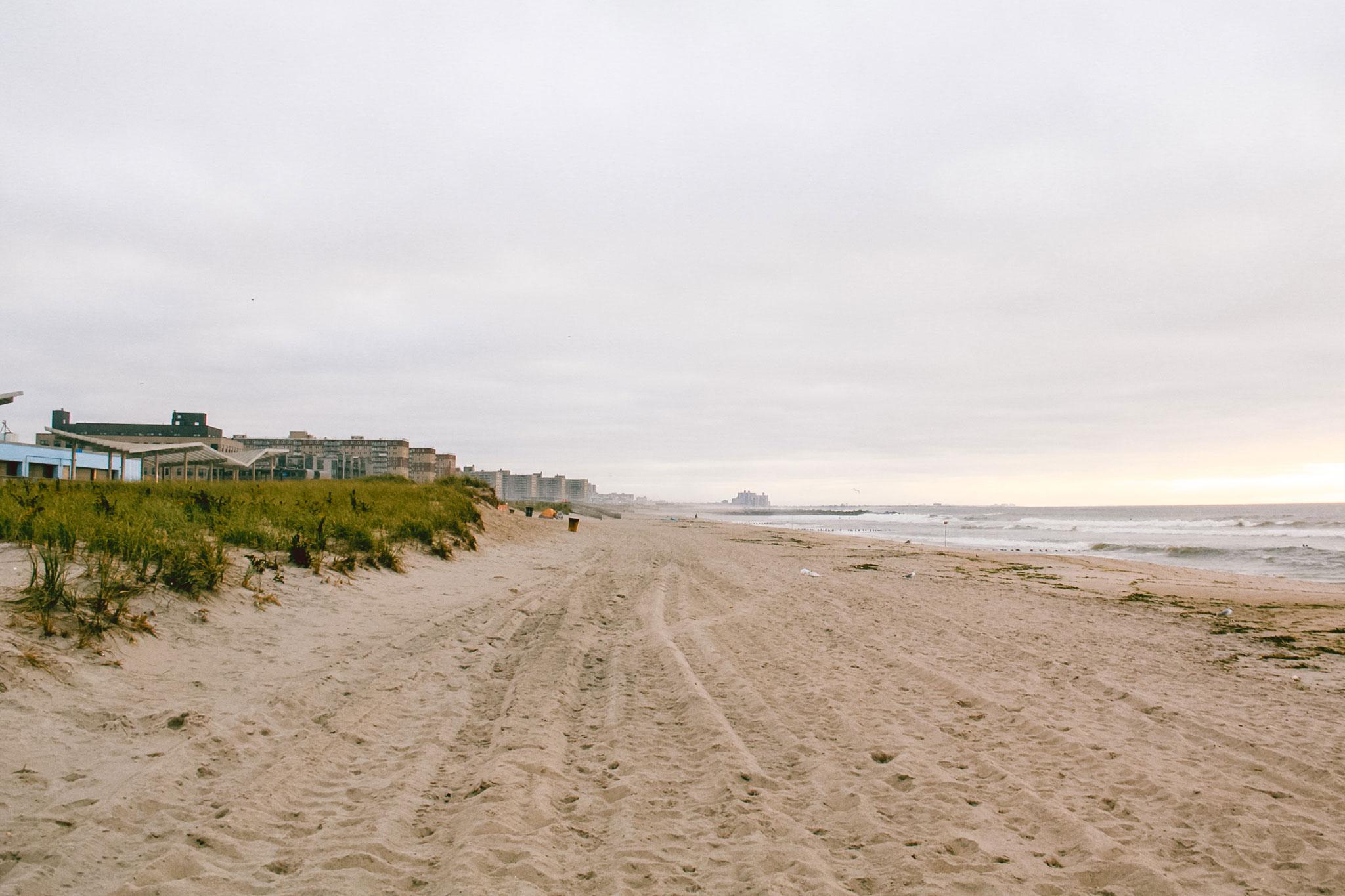 A long strip of sand beach.