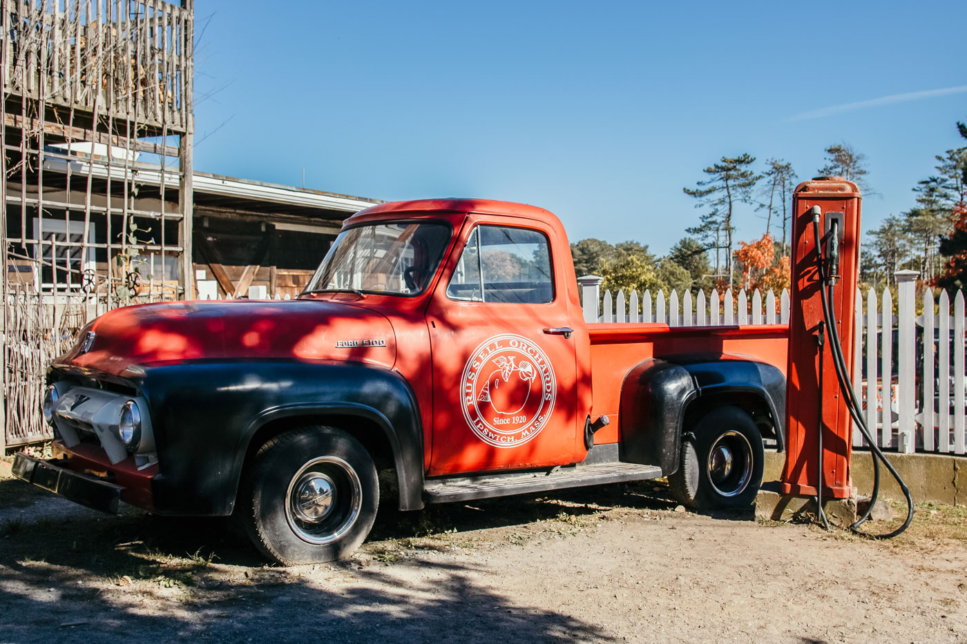 A red Russell Orchard pickup truck.