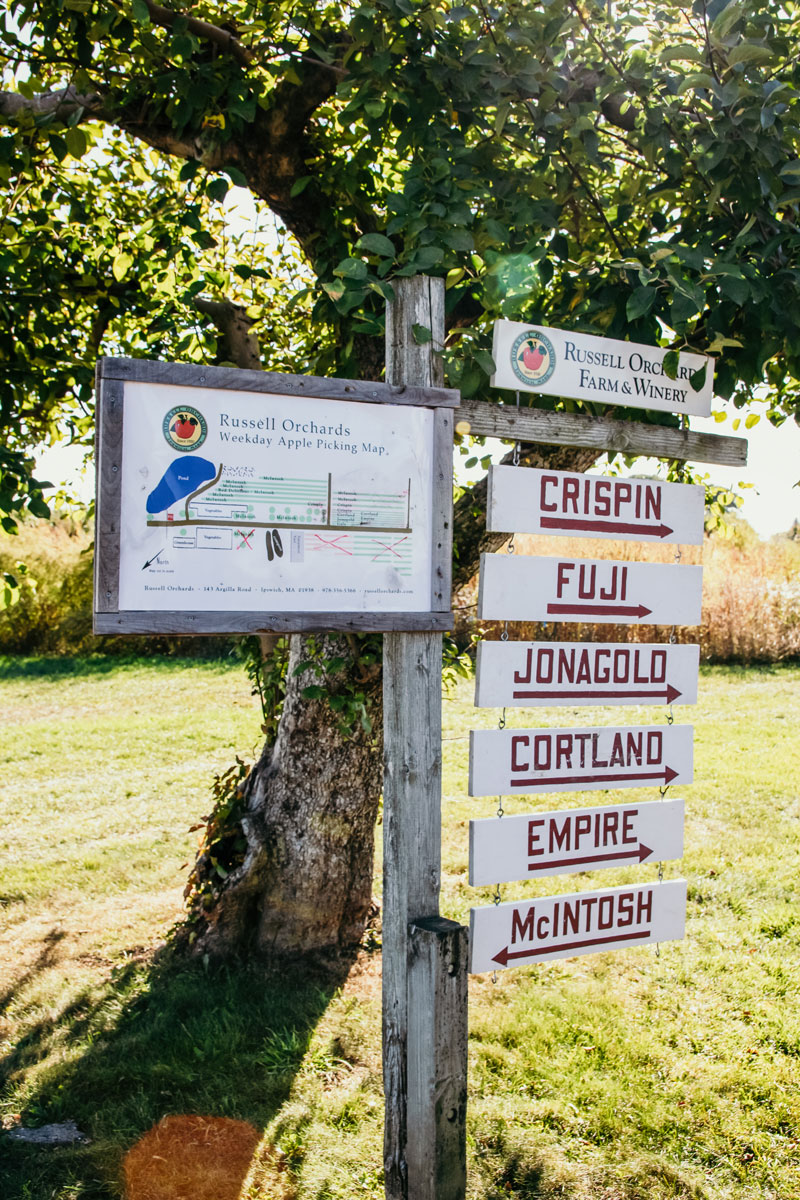 A sign with the variety of apples at Russell Orchard.