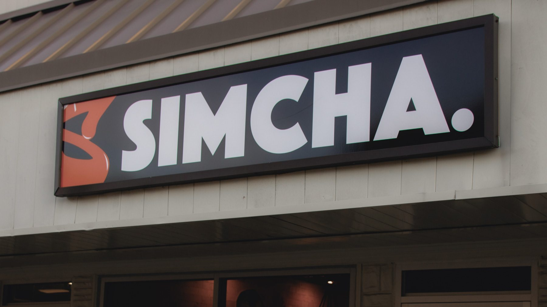 The restaurant sign for Simcha.