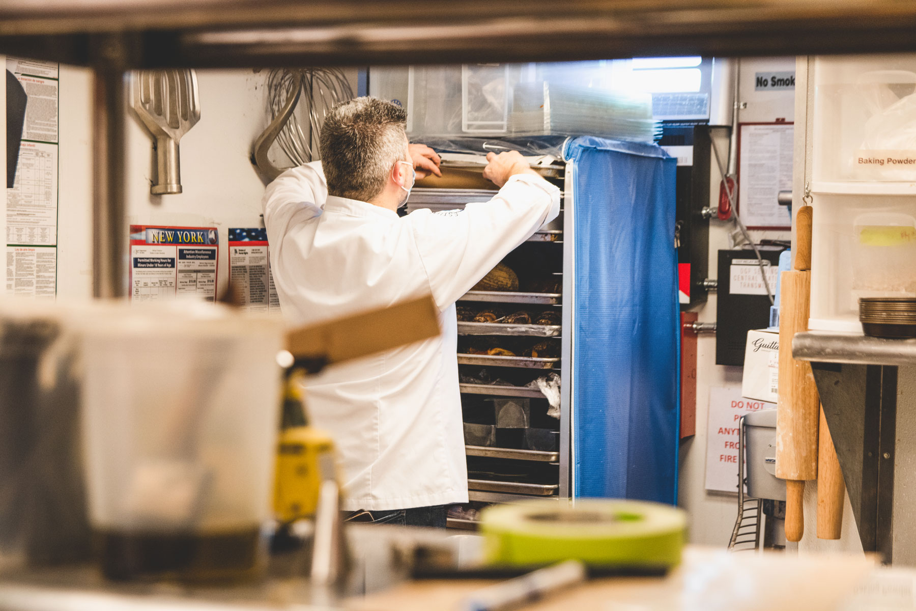 Chef Christophe Toury placing the chocolate into his baker's rack.