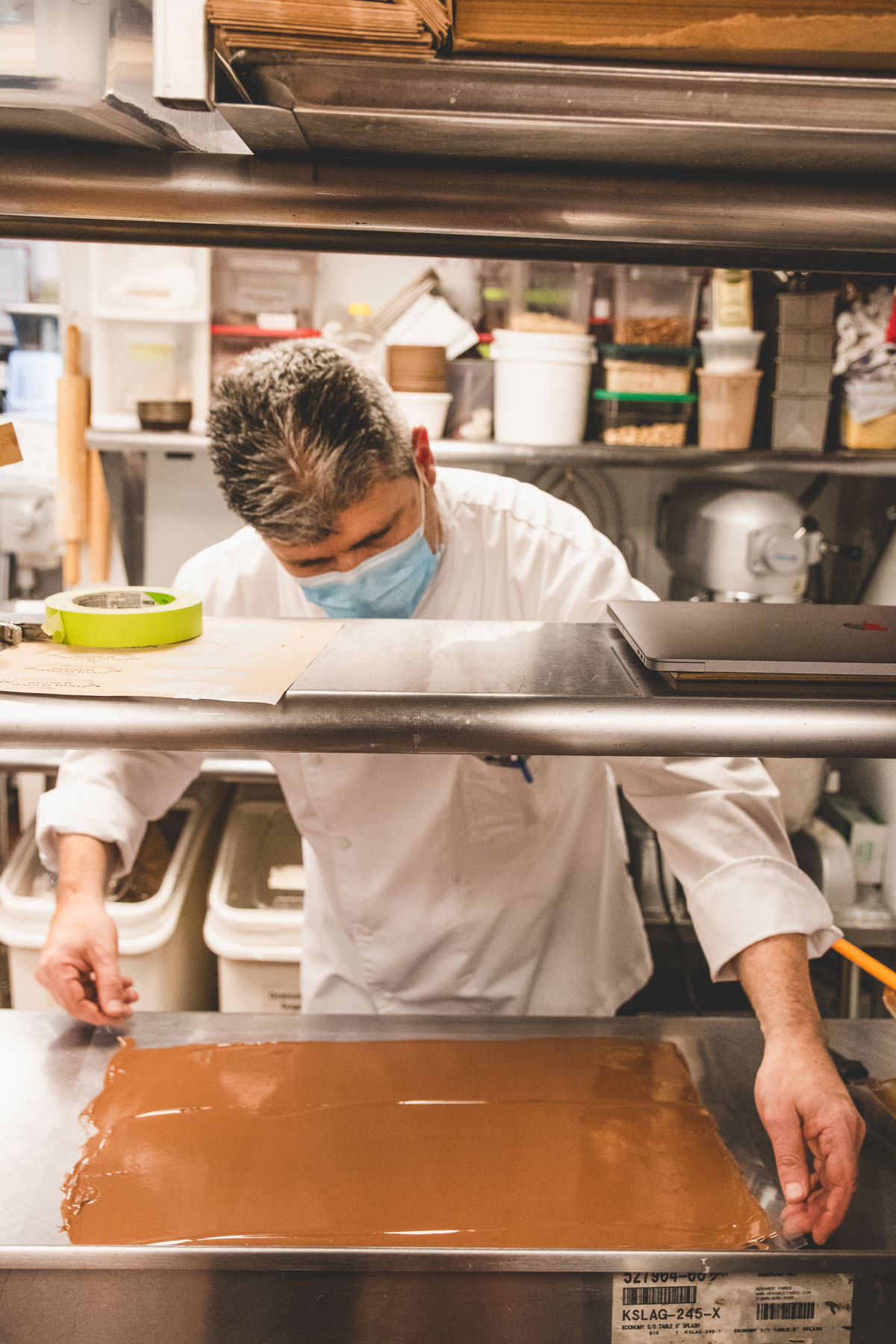 Chef Christophe Toury examining his chocolate.