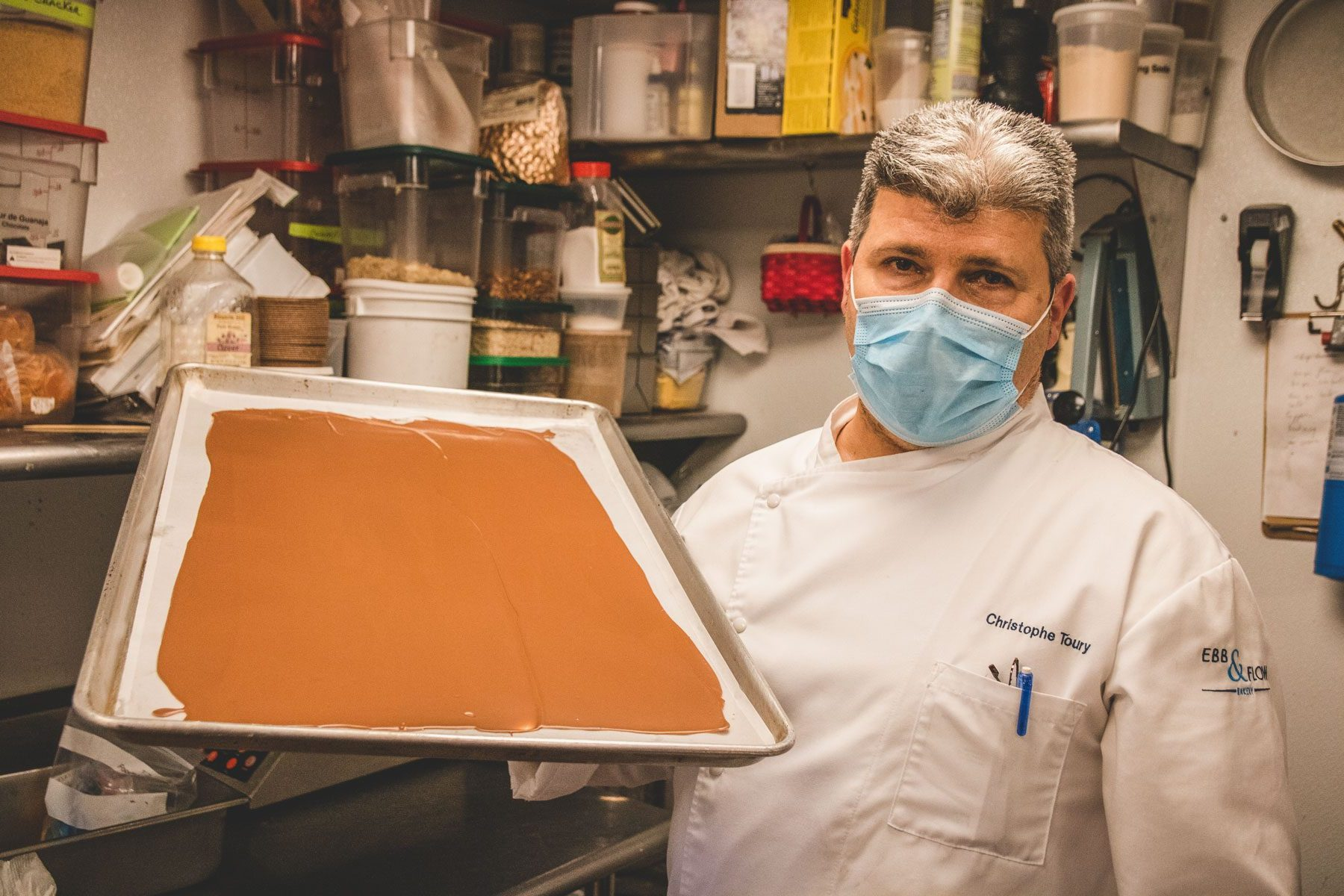 Chef Christophe Toury holding a sheet of chocolate.