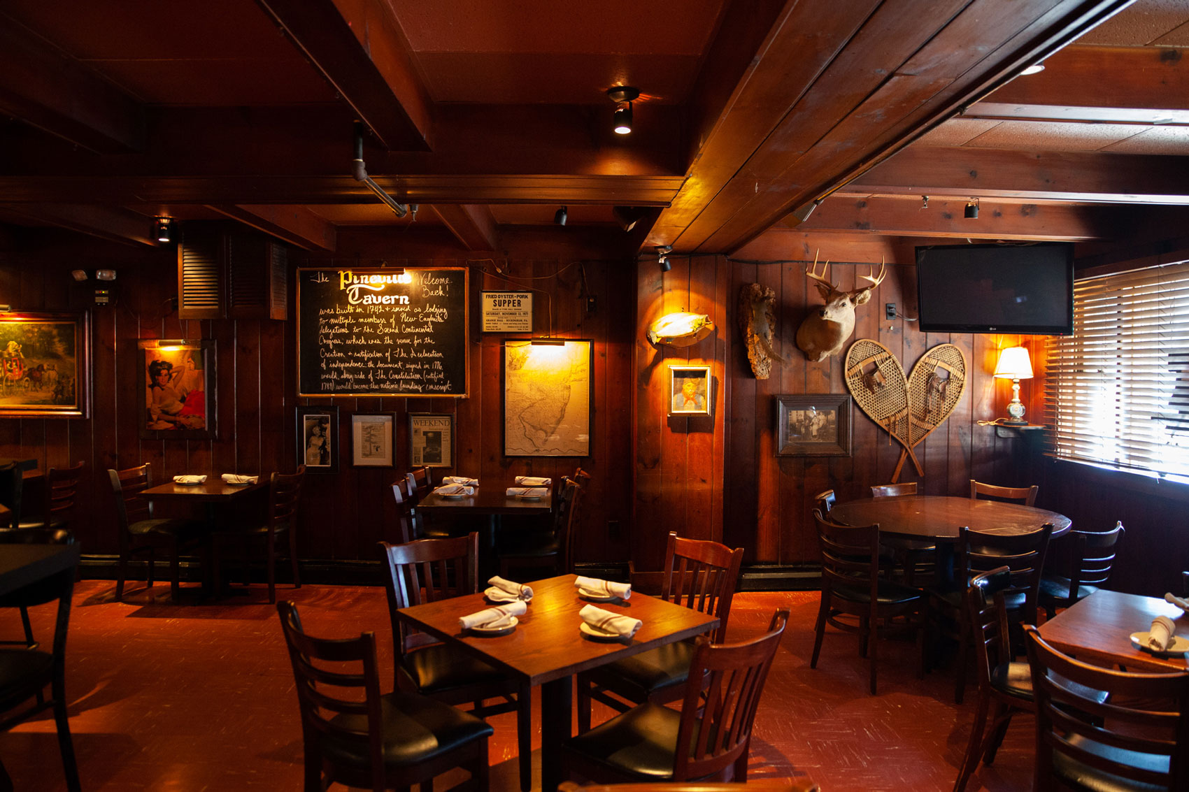 The clean, refined interior of the Pineville Tavern.