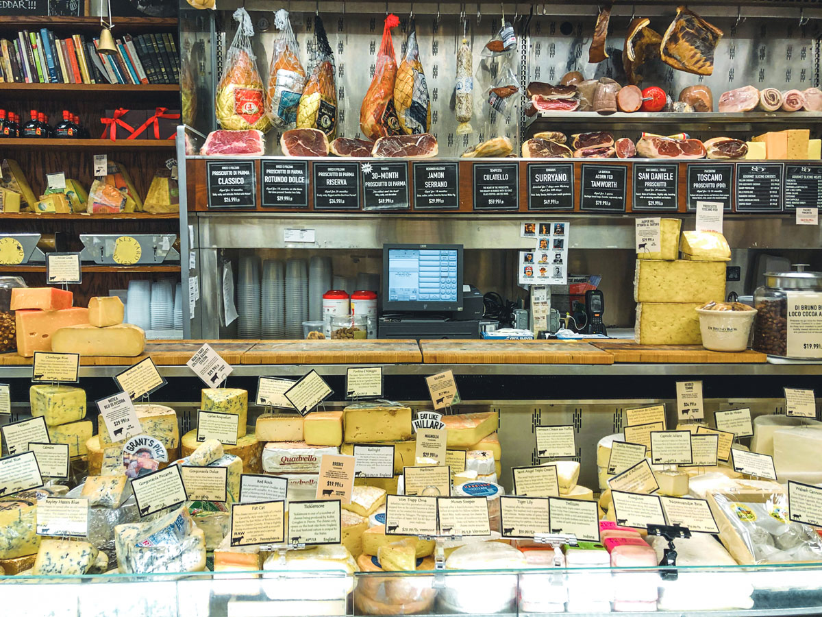 A store displaying a variety of high-quality meats and cheeses.