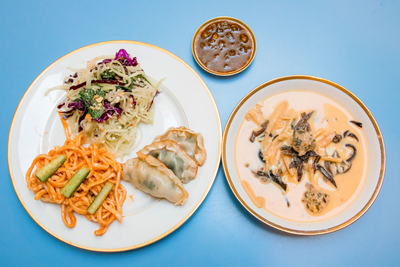 Plates filled with take-and-make orders from Myers + Chang.