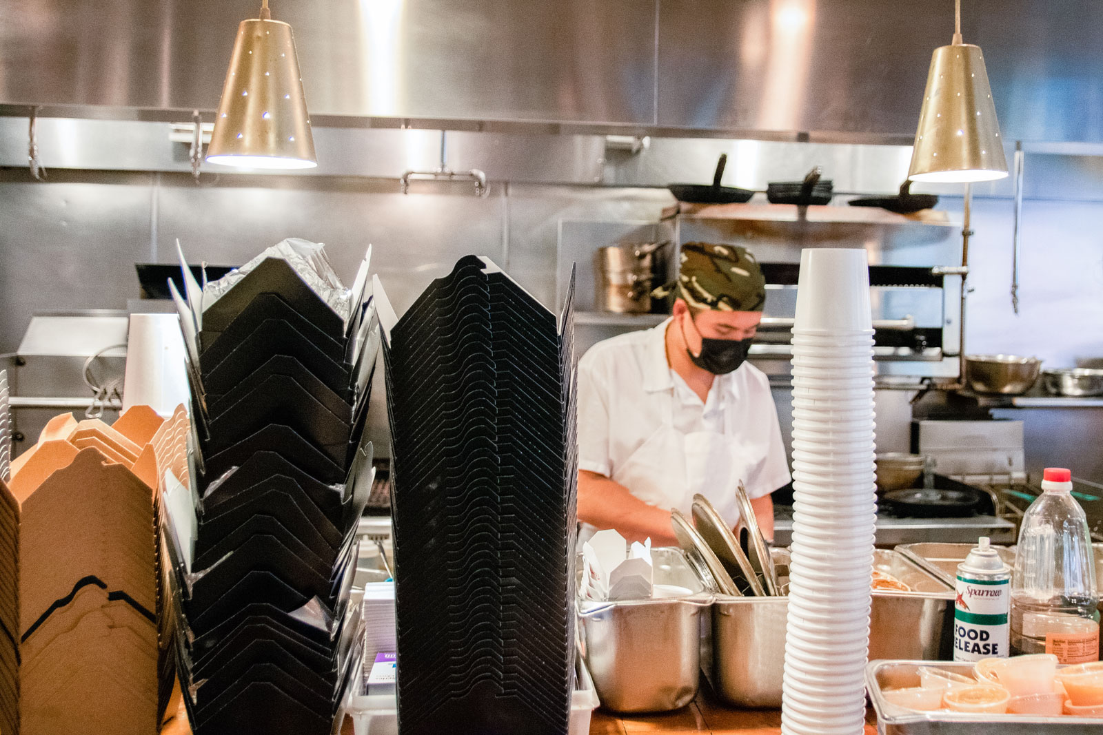 A chef working in the restaurant kitchen of Myers + Chang.