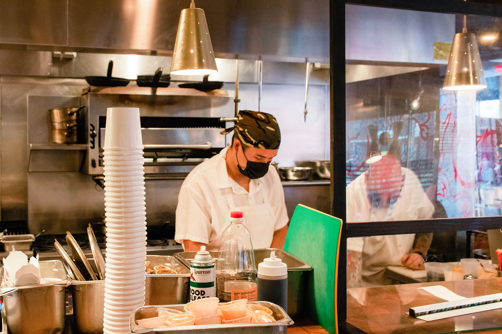 Chefs dilligently working in the restaurant kitchen of Myers + Chang.