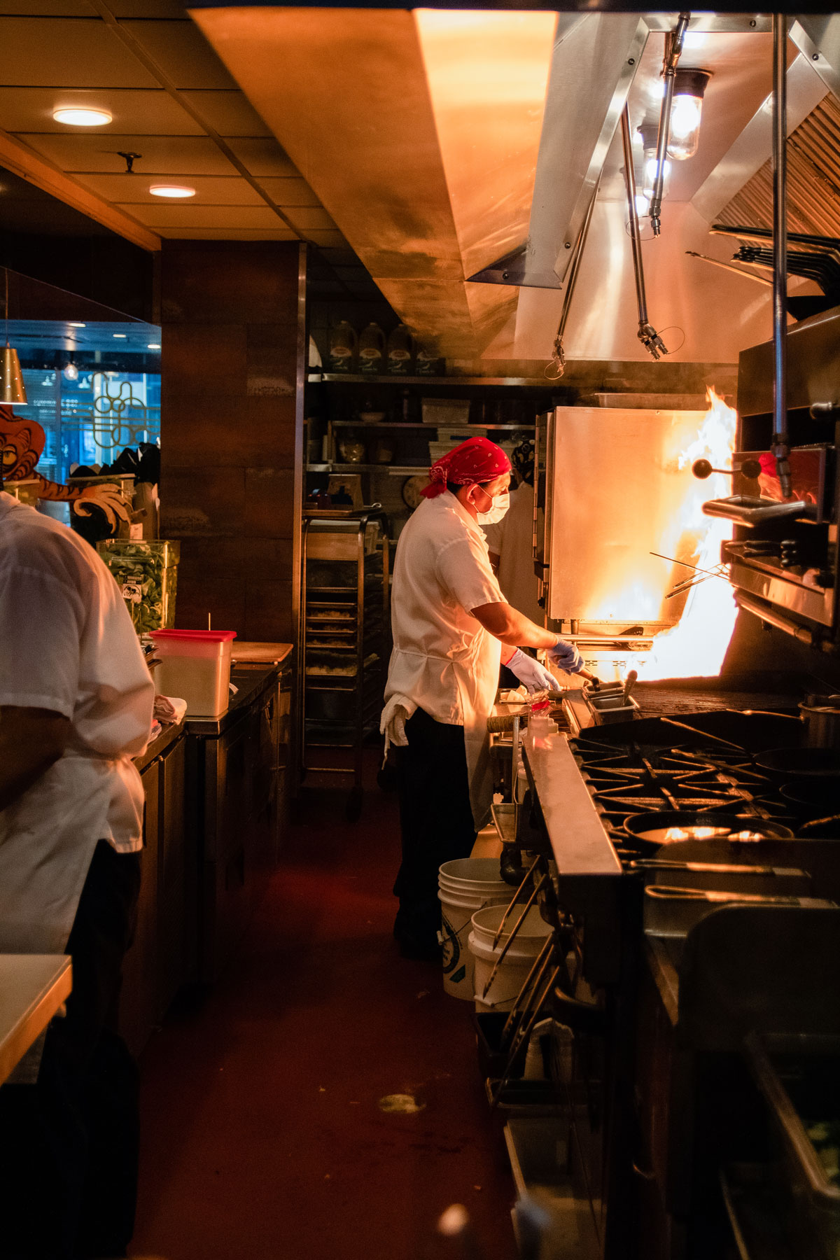 Chefs working in the restaurant kitchen of Myers + Chang.
