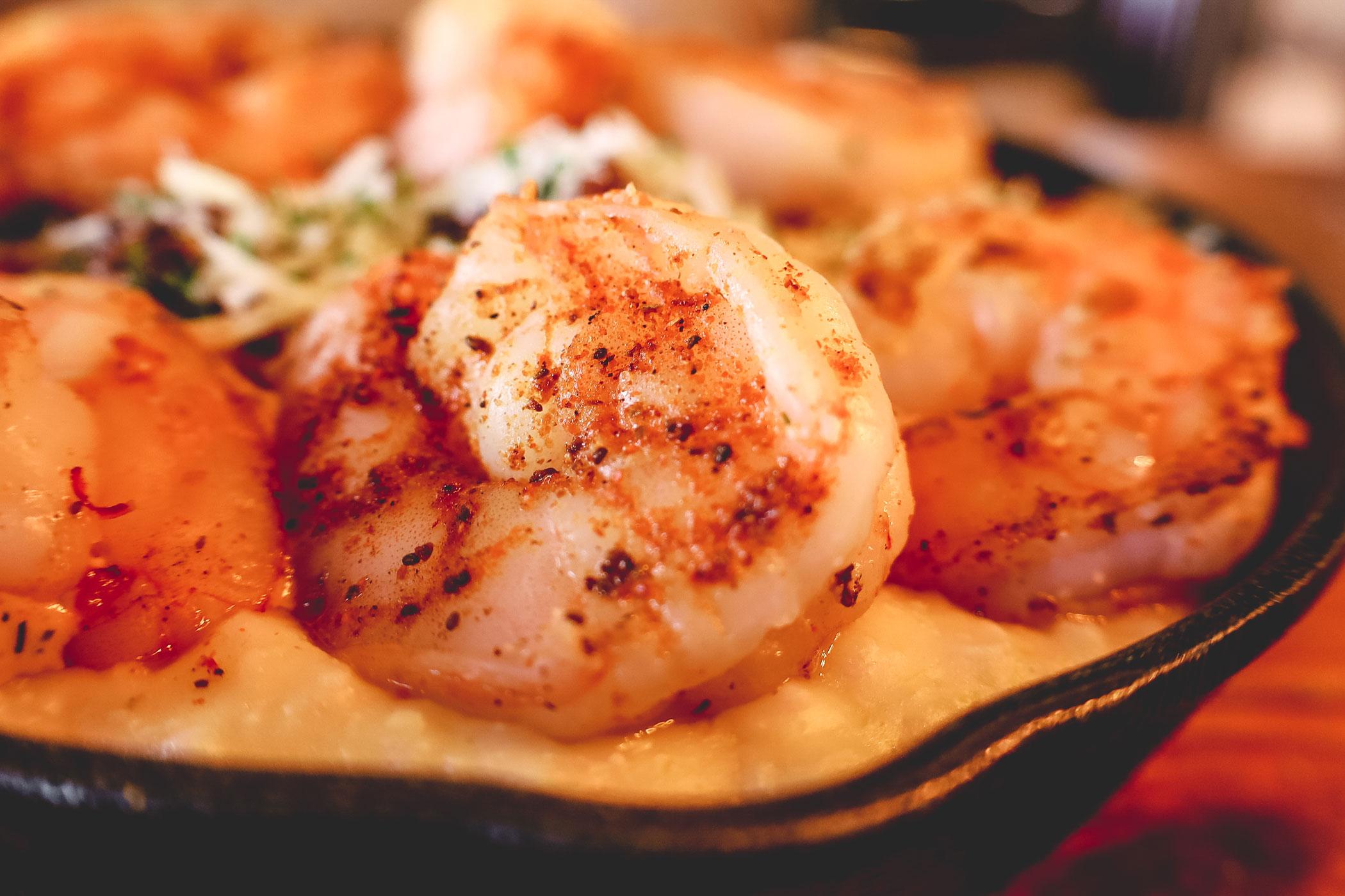 A closeup of a perfectly seasoned shrimp.