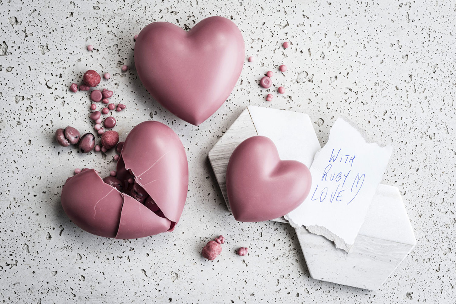A table of ruby chocolate hearts.