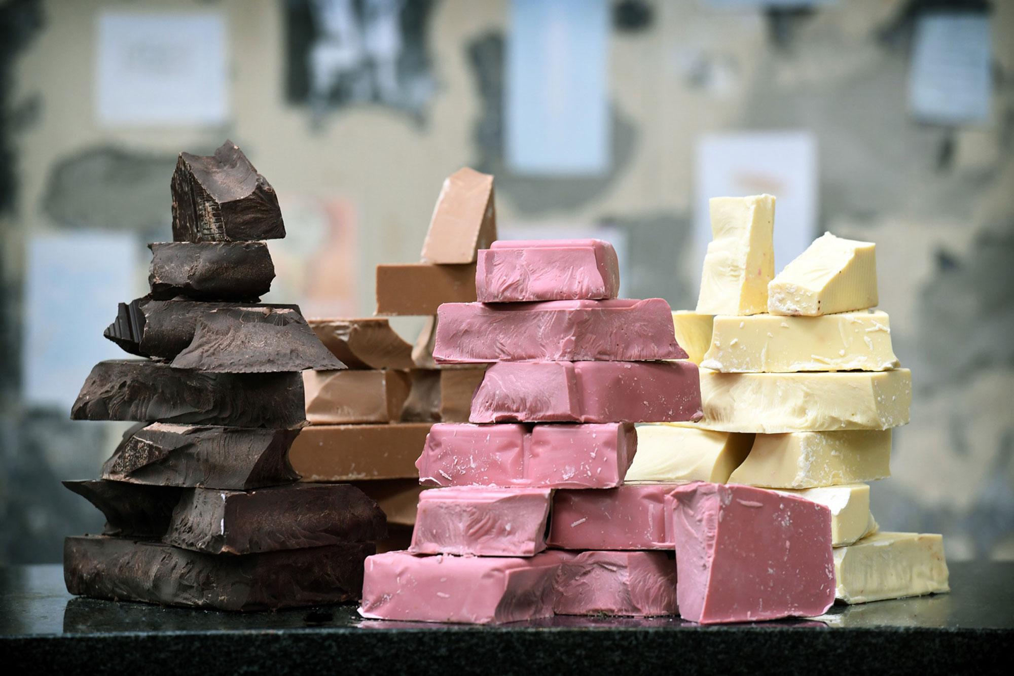 Chunks of the four chocolates: dark, milk, white and ruby.