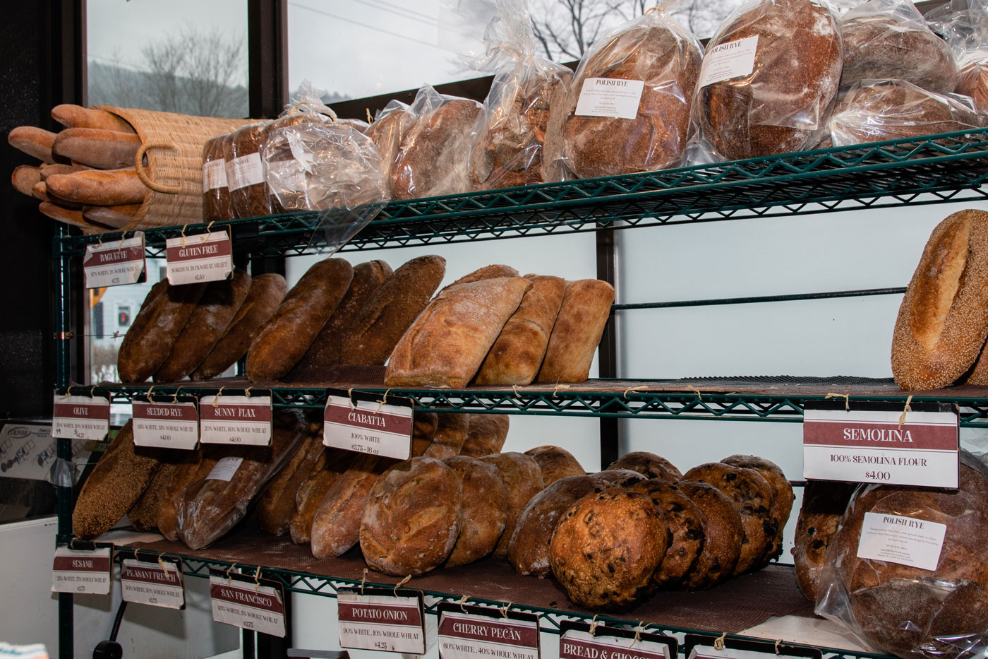 A variety of loaves of bread on display.