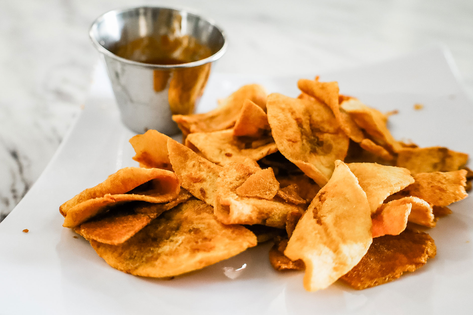 Plantain chips on a white plate.