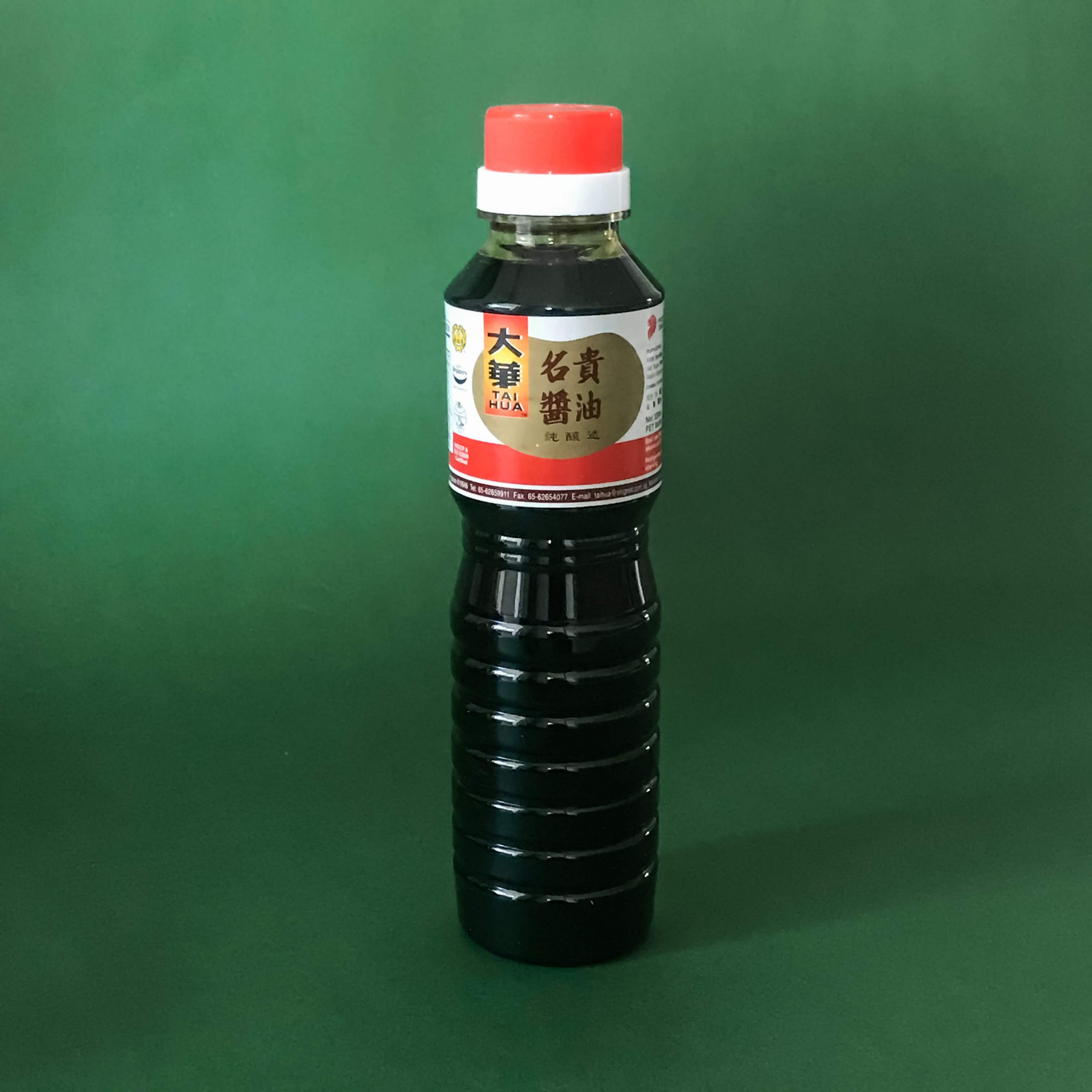 A tall bottle of Tai Hua Superior Dark Soy Sauce.