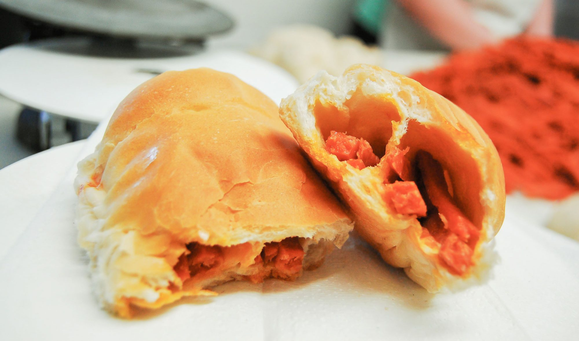 A pepperoni roll ripped in two.