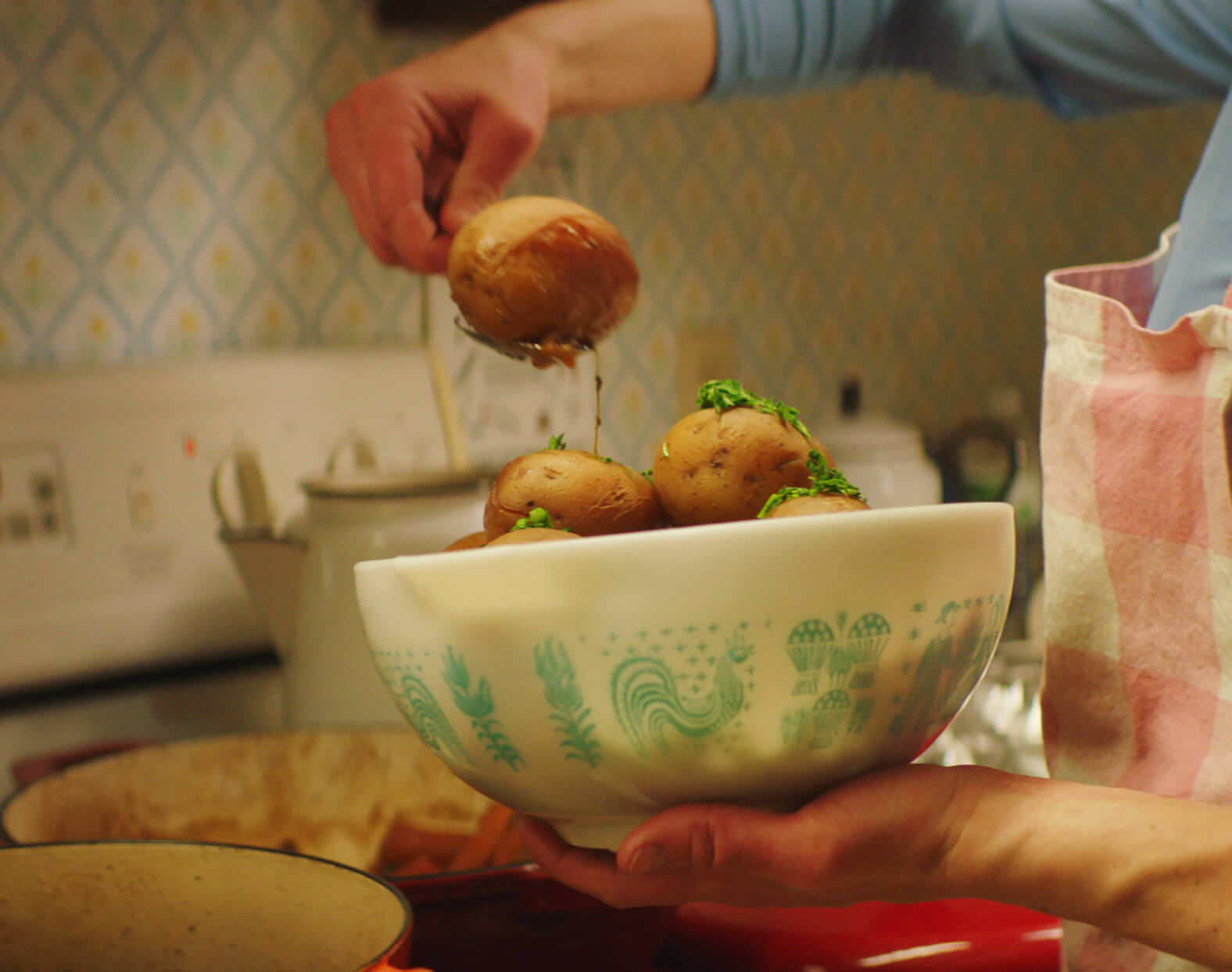 Karyn Tomlinson scooping potatoes out of a bowl.