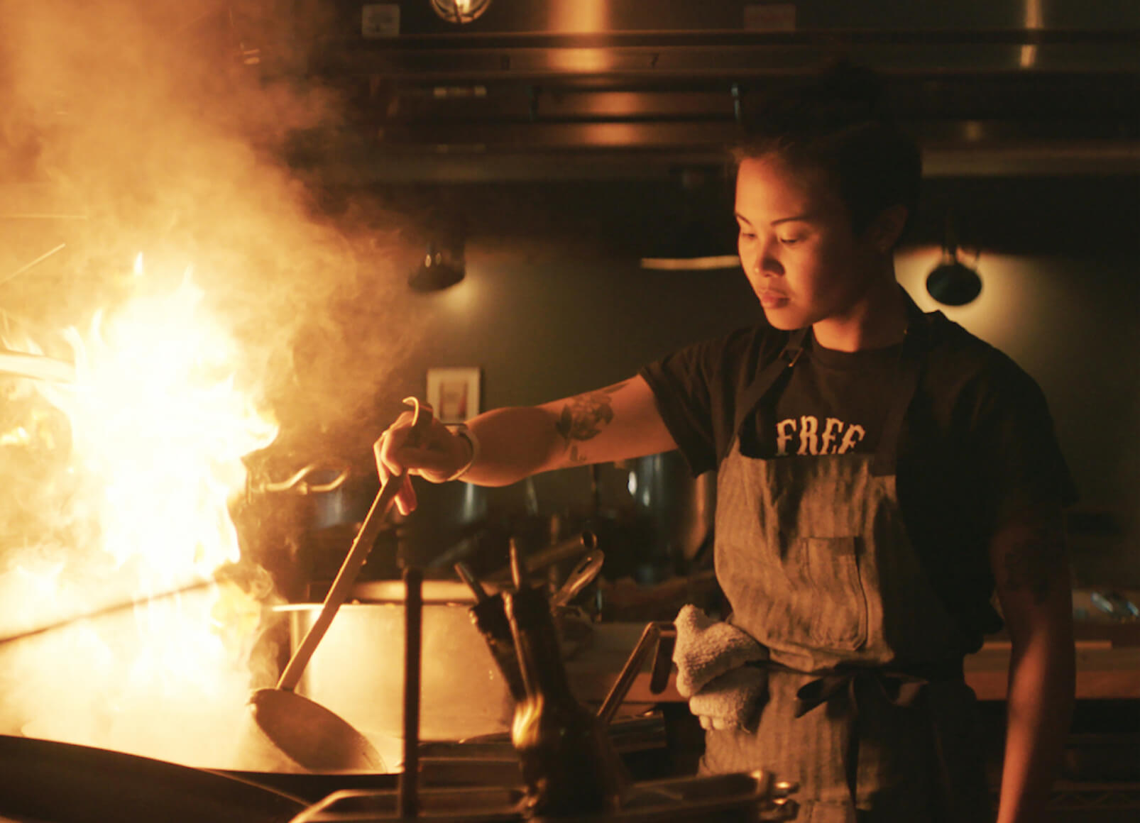 Marielle Fabie cooking over an open flame.
