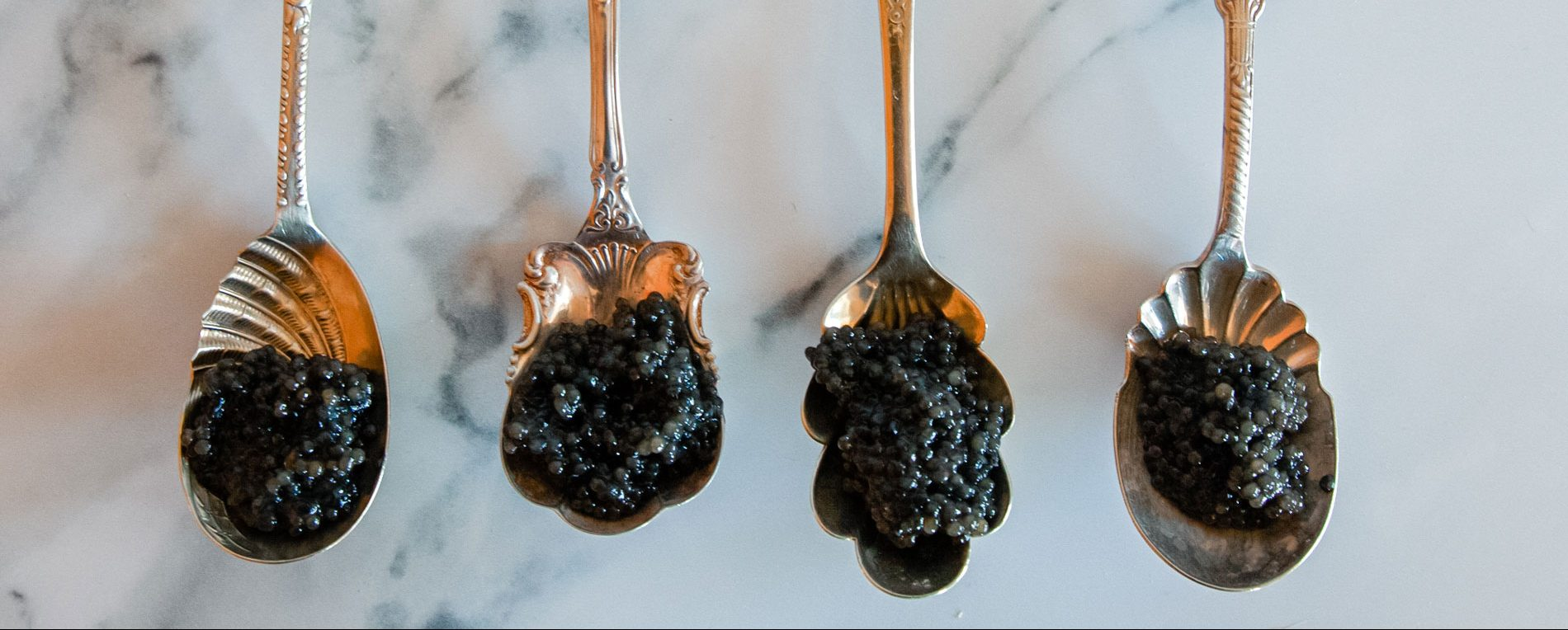 Ornate spoonfuls of black caviar.