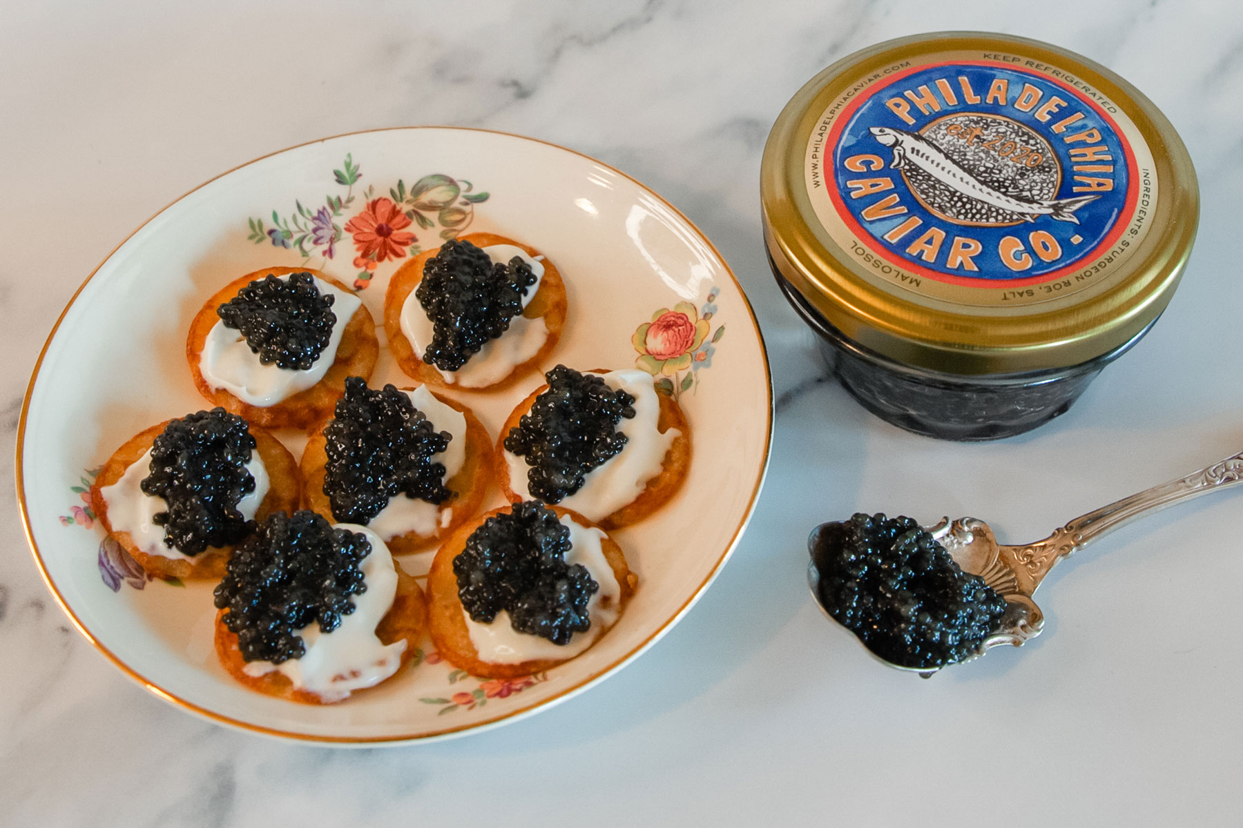 A plate of blinis topped with black caviar.
