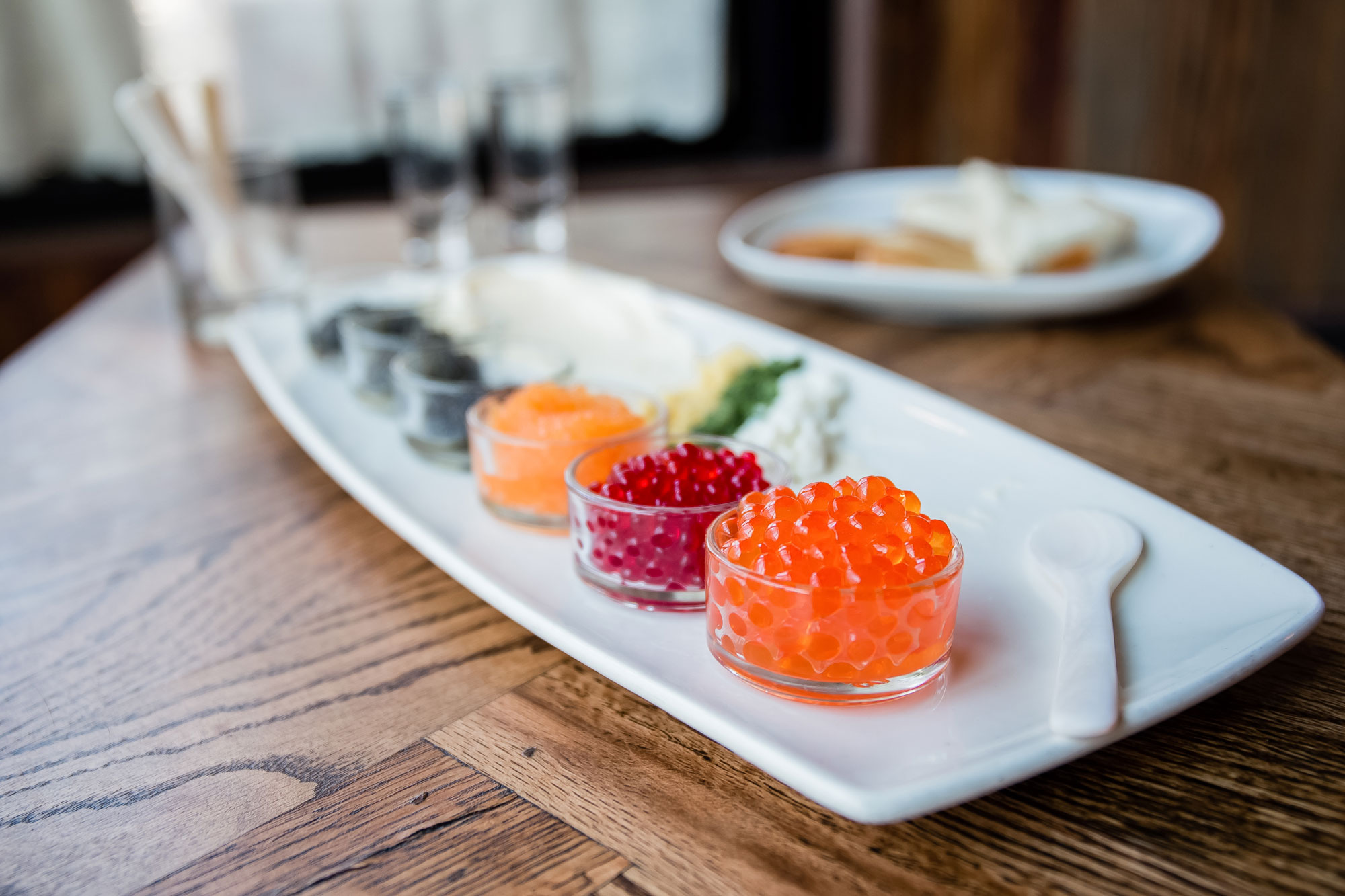 Colorful caviar in glass dishes.