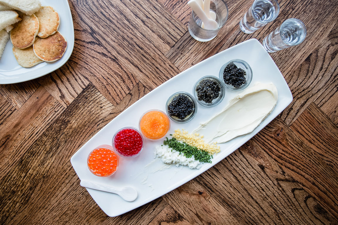 A variety of colorful caviar separated into individual glass dishes.