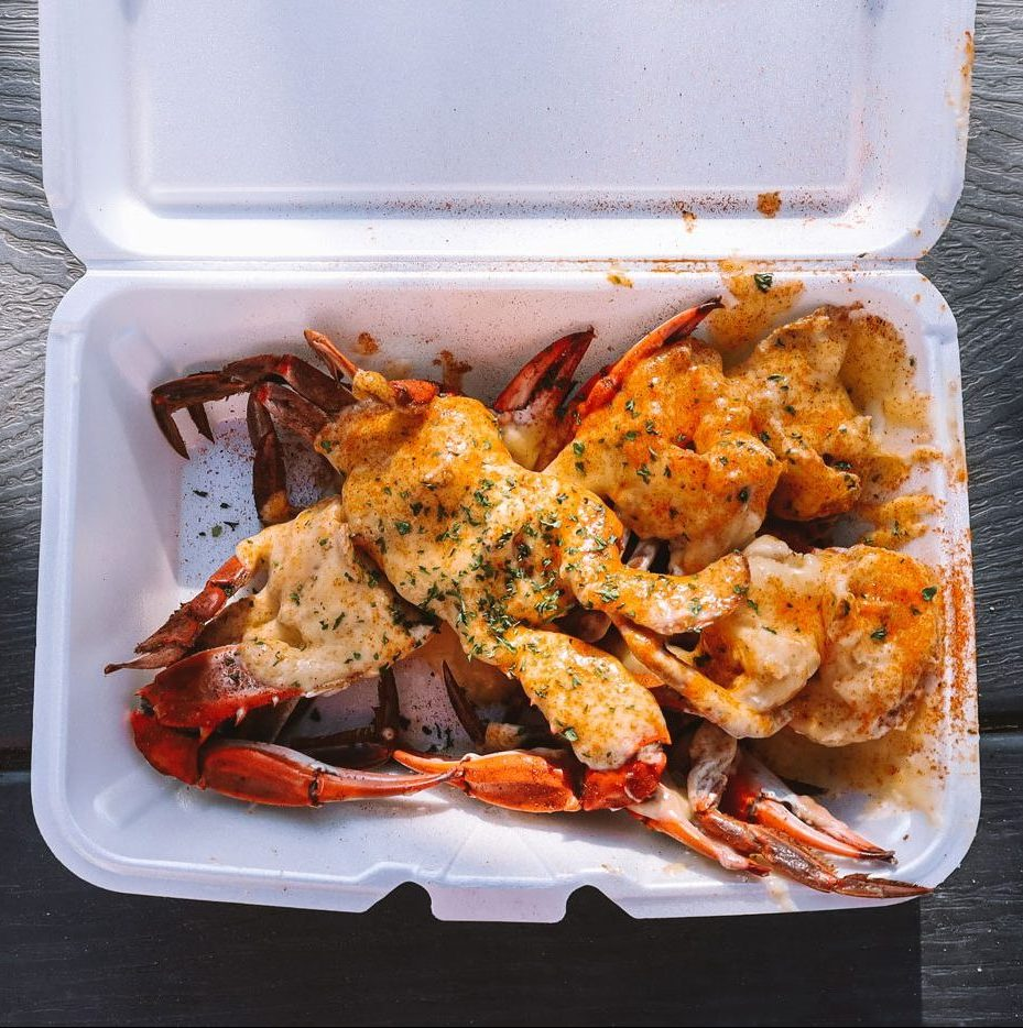 A to-go contained filled with delicious crab.