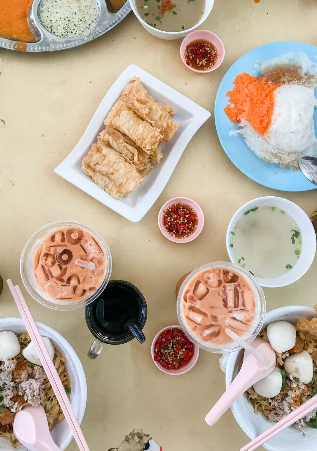 A table with drinks and different dishes.