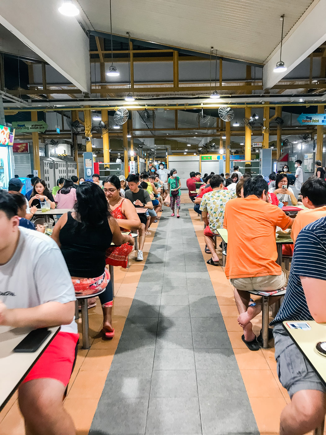A community of people sitting down to eat.
