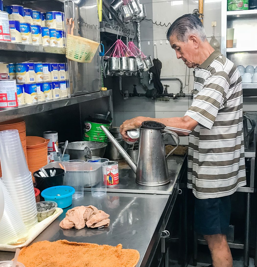 A person prepping in the kitchen.