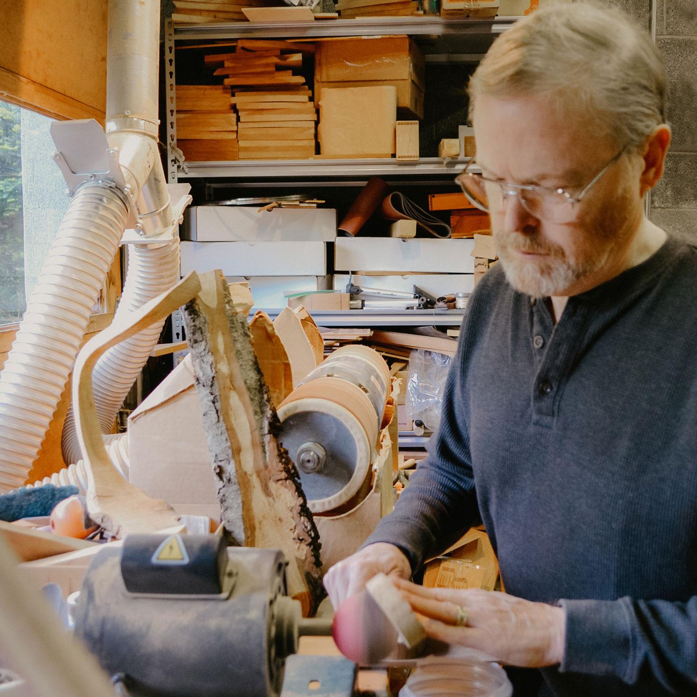 Jonathan Simons working with his tools.