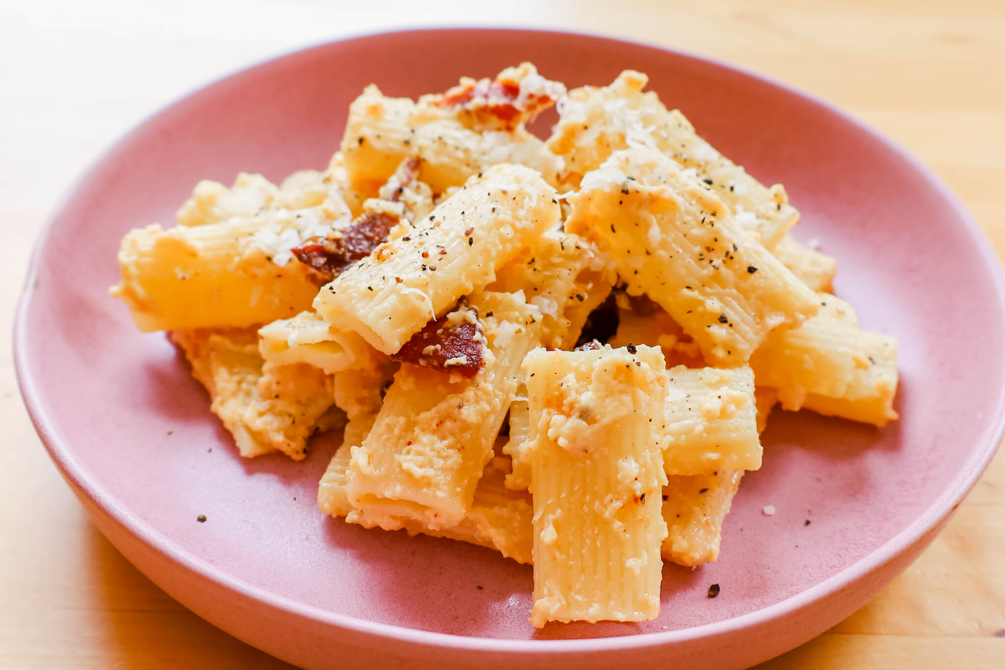 A plate of hearty pasta with parmesan.