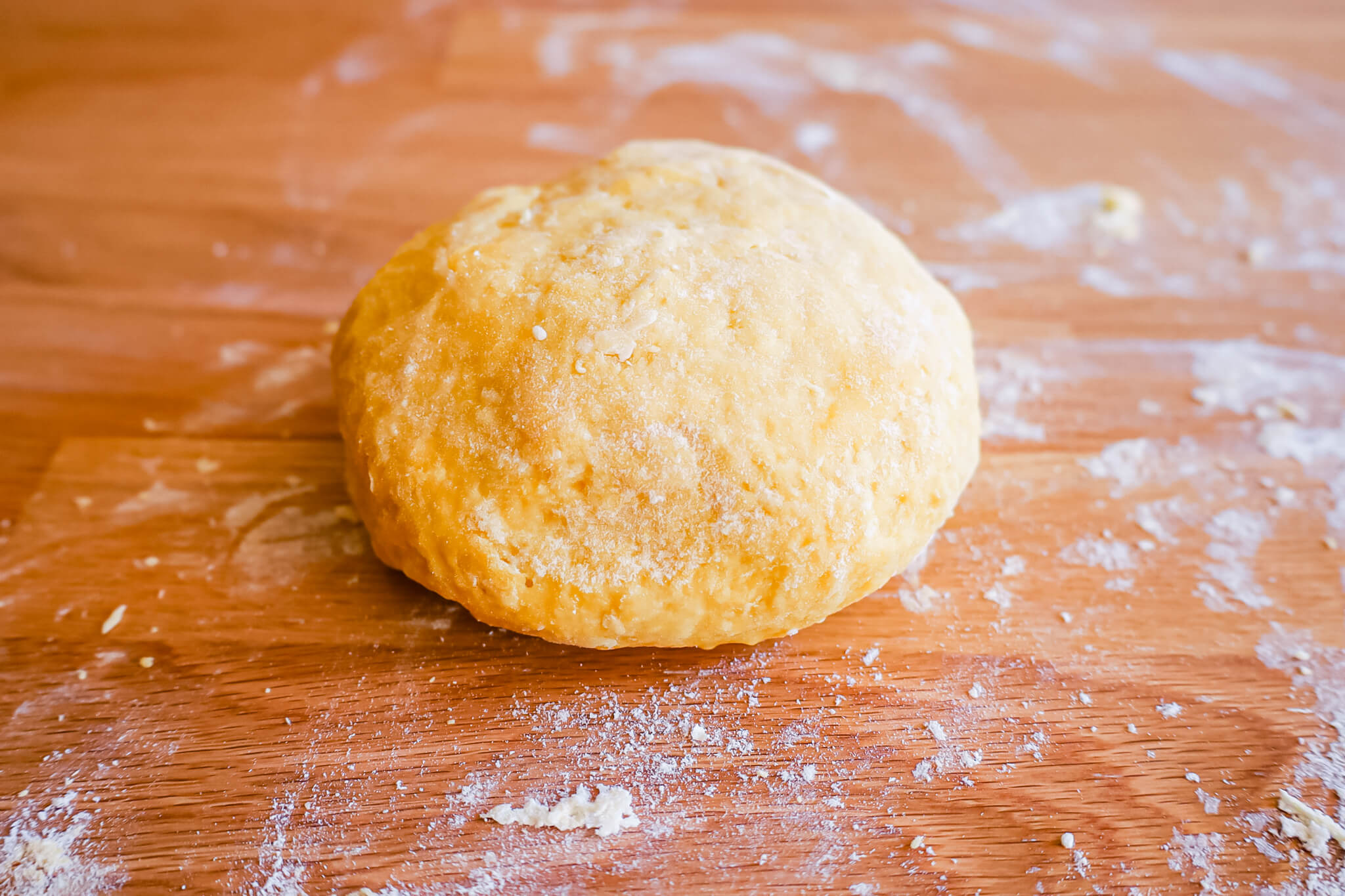 A ball of dough resting on a table.