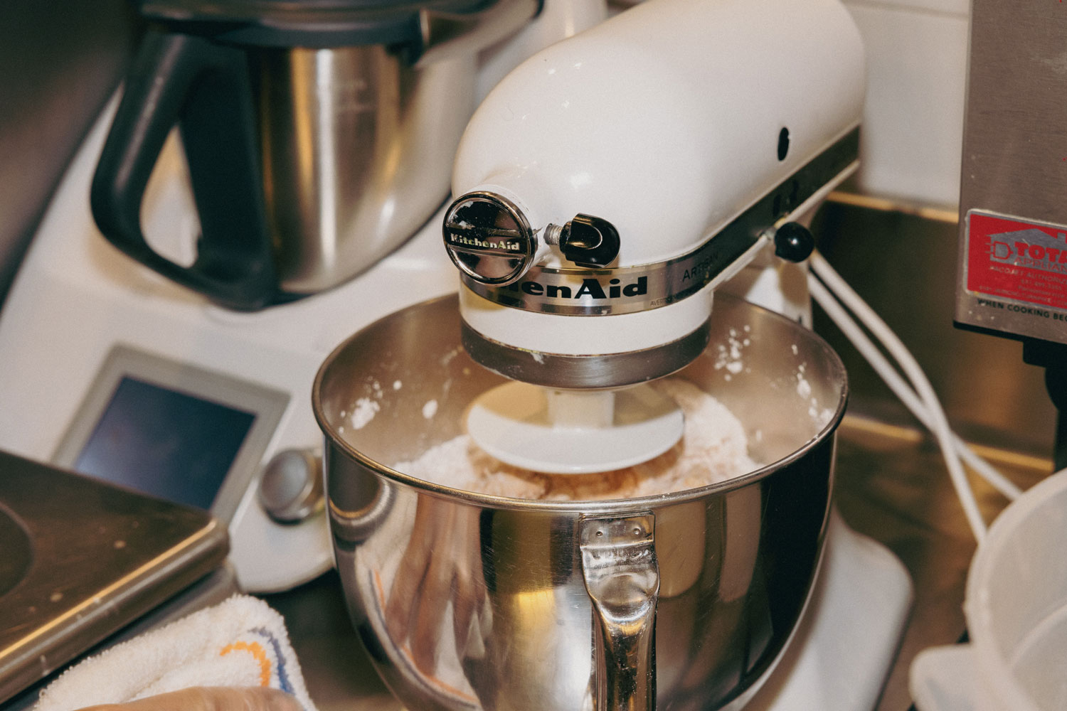 A stand mixer avidly mixing.